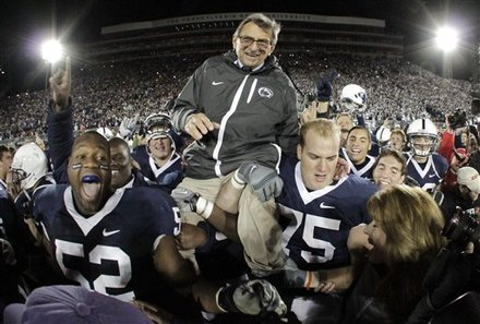 Penn State coach Joe Paterno is carried off the field  by his players after getting his 400th collegiate win, defeating Northwestern 38-21 in an NCAA college football game in State College, Pa., Saturday, Nov. 6, 2010.