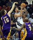 Memphis Grizzlies center Marc Gasol (33) of Spain shoots under pressure by his brother Los Angeles Lakers center Pau Gasol (16) of Spain and forward Lamar Odom (7) in the first half of an NBA basketball game Tuesday, Nov. 30, 2010 in Memphis, Tenn.