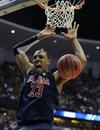 Arizona's Derrick Williams dunks during the second half of
