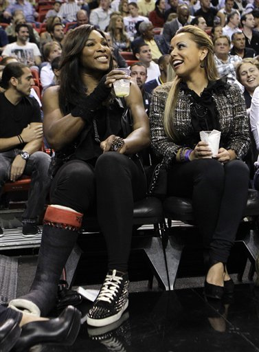 Tennis Player Serena Williams, Left, Sits