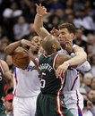 Los Angeles Clippers forward Blake Griffin , right, fouls Milwaukee Bucks forward Corey Maggette as Randy Foye grabs a loose ball during the second half of an NBA basketball game in Los Angeles, Monday, Jan. 31, 2011. The Clippers won 105-98.