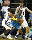 New Orleans Hornets ' Chris Paul , middle, works between Memphis Grizzlies ' Mike Conley , left, and Marc Gasol , of Spain, during the second half of a preseason NBA basketball game in Memphis, Tenn., Monday, Oct. 18, 2010.