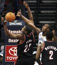 Portland Trail Blazers center Marcus Camby (23) tries to pull down a rebound under pressure from Memphis Grizzlies forward Darrell Arthur , right, in the first half of an NBA basketball game Tuesday, Nov. 16, 2010 in Memphis, Tenn.