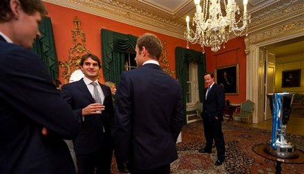 Swiss Tennis Star, Roger Federer, 2nd Left, Talks With US Player Andy Roddick, As British Prime Minister David Cameron,