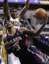 Atlanta Hawks forward Josh Smith , front, is fouled as he shoots under Indiana Pacers center Solomon Jones in the first half of an NBA basketball game in Indianapolis, Tuesday, Nov. 16, 2010.
