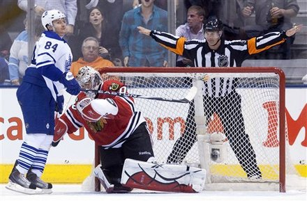 Toronto Maple Leafs ' Mikhail Grabovski , left, reacts after having his shootout-attempt stopped by Chicago Blackhawks goaltender Corey Crawford during third-period NHL hockey game action in Toronto, Saturday, March 5, 2011. The Blackhawks won 5-3.