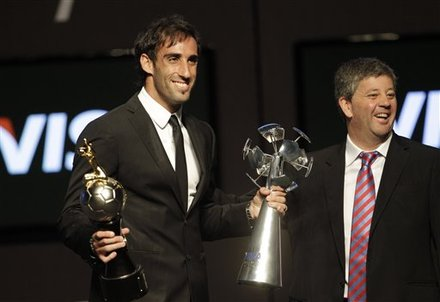 Argentina's Roberto Nanni, Left, Who Plays For Paraguay Soccer Team Cerro Porteno, Holds The Trophies For Best Player