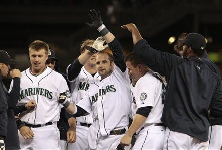 Seattle Mariners' Adam Kennedy, Center, Celebrates