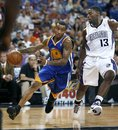 Golden State Warriors guard Monta Ellis , left, drives against Sacramento Kings defender Tyreke Evans during the first half of an NBA preseason basketball game in Sacramento, Calif., Tuesday, Oct. 12, 2010.