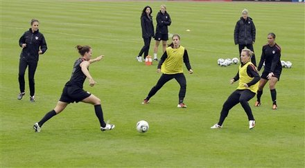United States players go through passing drills during a training session in preparation for a match against Sweden during the Women's Soccer World Cup in Wolfsburg, Germany, Monday, July 4, 2011.