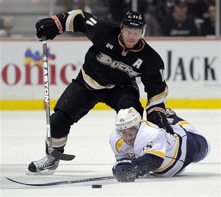 Anaheim Ducks Center Saku Koivu, Top, Of Finland, And Nashville Predators Center Craig Smith Vie For The Puck