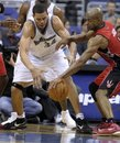 Toronto Raptors guard Jarrett Jack , right, strips the ball from Washington Wizards center JaVale McGee (34) during the first quarter of their NBA basketball game at the Verizon Center in Washington, Tuesday, Nov. 16, 2010.