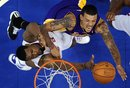 Los Angeles Lakers small forward Matt Barnes , right, Los Angeles Clippers center DeAndre Jordan defends during the second half of their NBA basketball game, Wednesday, Dec. 8, 2010, in Los Angeles. The Lakers won 87-86.