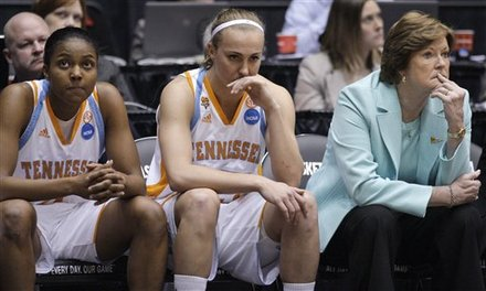 Tennessee coach Pat Summitt and players Vicki Baugh, left, and Alicia Manning watch in the closing minute of Tennessee's 73-59 loss to Notre Dame in an NCAA women's college basketball tournament regional final, Monday, March 28, 2011, in Dayton, Ohio .