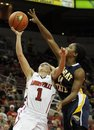 Louisville's Shelby Harper, left, is fouled by Murray State 's Erica Burgess as she attempts a layup during the second half of their NCAA women's college basketball game, Tuesday, Nov. 29, 2011, in Louisville, Ky. Louisville defeated Murray State 105-62.