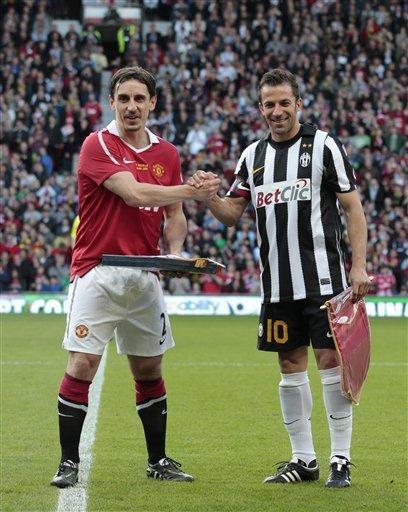 Manchester United''s Gary Neville, Left, Shakes