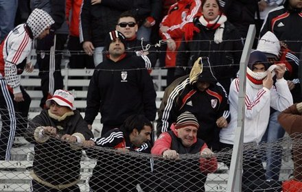 River Plate Soccer Fans Try To Tear Down The Fence That Separates The Stands From The Field At The End Of An Argentine