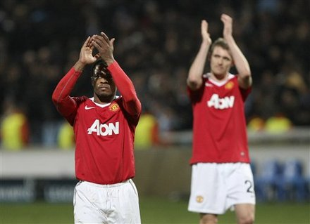 Manchester United''s French Defender Patrice Evra, Left, And Fellow Team Member Darren Fletcher, React At The End Of
