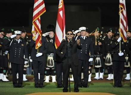 Grammy-award Winning Singer/songwriter Marc Anthony, Center, Sings The National Anthem In A Sept. 11th Remembrance