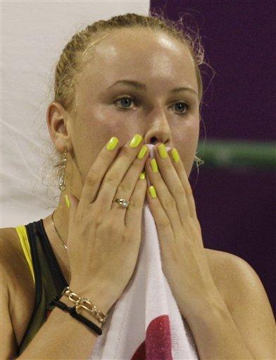 Denmark's Caroline Wozniacki Reacts