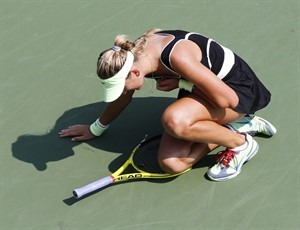 Azarenka collapses, wheeled off court