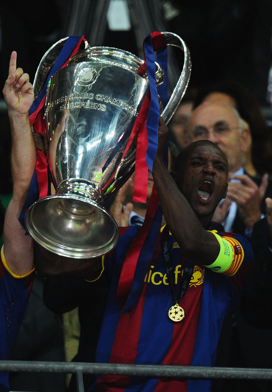 LONDON, ENGLAND - MAY 28:  Eric Abidal of FC Barcelona lifts the trophy after victory in the UEFA Champions League final between FC Barcelona and Manchester United FC at Wembley Stadium on May 28, 2011 in London, England.  (Photo by Clive Mason/Getty Images)