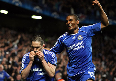 Chelsea's Frank Lampard and Florent Malouda