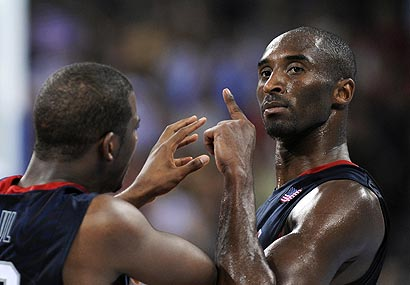 Kobe Bryant and Chris Paul celebrate after Bryant hit a shot to help close out Team USA's victory over Spain.