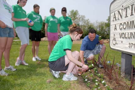 Josh Fogg joins Cincinnati Action Team during a Spring landscaping event at a Volunteers of America senior center.