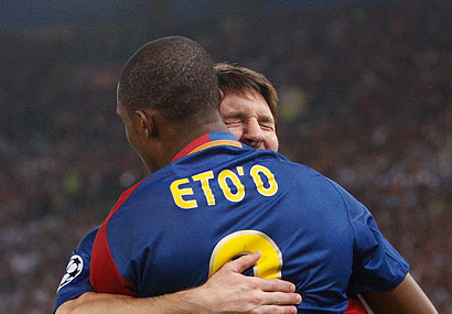 Lionel Messi celebrates the game's first goal, by Barcelona teammate Samuel Eto'o. Messi followed with a score of his own in the second half.