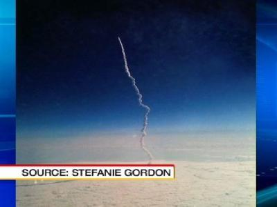 Woman Snaps Shuttle Photo From Plane