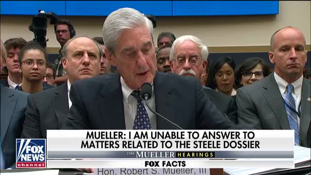 Mueller corrects testimony, says his probe did not reach determination as to whether Trump committed a crime