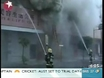 Blaze in Chinese high-rise claims 21