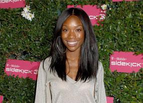 Beleaguered Brandy Suits Herself(E! Online)