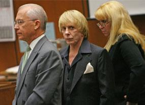 Spector Trial Gets Grim as Coroner Testifies(E! Online)