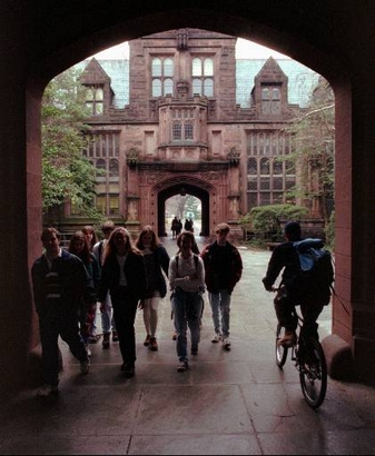 **FILE PHOTO** Princeton University students walk and ride through an archway between classes on the Princeton, N.J., campus. (AP Photo/Charles Rex Arbogast)