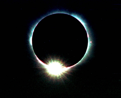 The sun appears as a diamond ring as the moon passes over during the solar eclipse in Graz, about 200 kilometers (167 miles) south of Vienna, Austria on Wednesday, Aug. 11 1999. (AP Photo/Helge O. Sommer)