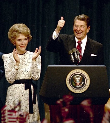 President Ronald Reagan gives a thumbs-up to supporters at the ...