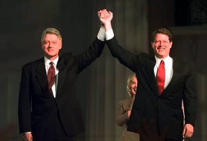 President Clinton and Vice President Al Gore raise their hands ...