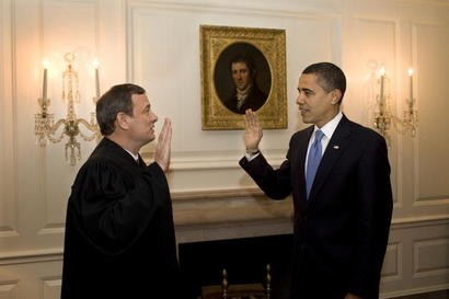 Chief Justice John G. Roberts Jr. administers the oath of office to President Barack Obama a second time in the Map Room of the White House January 21
