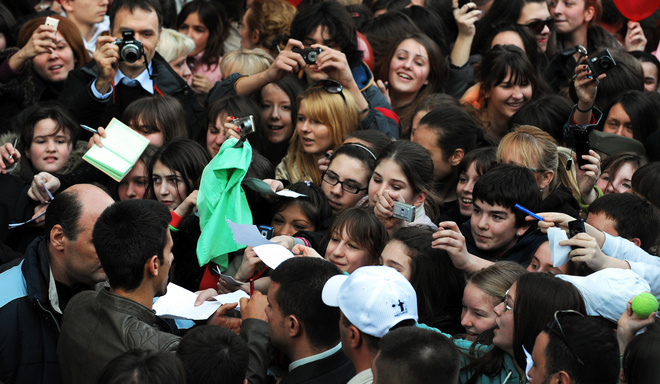 Serbian tennis player Novak Djokovic (L) signs his autograph for fans during a welcome ceremony in Belgrade, 02 February 2008. Novak Djokovic broke through for his first Grand Slam triumph with a dramatic four-set victory over unseeded Frenchman Jo-Wilfried Tsonga at the Australian Open on January 27.          AFP PHOTO / DIMITAR DILKOFF (Photo credit should read DIMITAR DILKOFF/AFP/Getty Images)