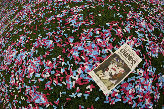 GLENDALE, AZ - FEBRUARY 03: The front page paper is seen on a confetti strewn field after the New York Giants reacts defeated the New England Patriots 17-14 during Super Bowl XLII on February 3, 2008 at the University of Phoenix Stadium in Glendale, Arizona. (Photo by Donald Miralle/Getty Images)