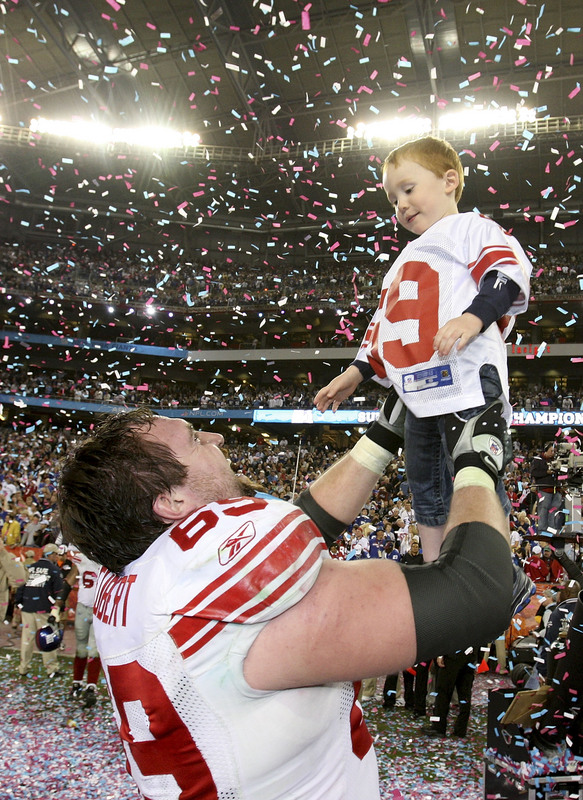 GLENDALE, AZ - FEBRUARY 03: Rick Seubert #69 of the New York Giants celebrates with his son Hunter after the Giants defeated the New England Patriots 17-14 in Super Bowl XLII on February 3, 2008 at the University of Phoenix Stadium in Glendale, Arizona. (Photo by Andy Lyons/Getty Images)