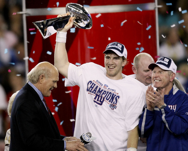 GLENDALE, AZ - FEBRUARY 03: Quarterback Eli Manning #10 of the New York Giants holds the Vince Lombardi Trophy after defeating the New England Patriots 17 0 14 after Super Bowl XLII on February 3, 2008 at the University of Phoenix Stadium in Glendale, Arizona. (Photo by Win McNamee/Getty Images)