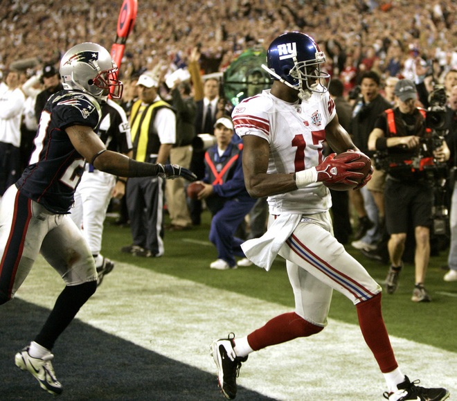 Plaxico Burress of the New York Giants goes into the endzone against Randall Gay of the New England Patriots to score the winning touchdown during Super Bowl XLII at the University of Phoenix Stadium in Glendale, Arizona, 03 February 2008. The Giants won 17-14. AFP PHOTO/Timothy A. CLARY (Photo credit should read TIMOTHY A. CLARY/AFP/Getty Images)