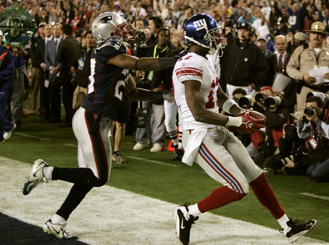 Plaxico Burress (R) of the New York Giants goes into the endzone against Randall (L) Gay of the New England Patriots to score the winning touchdown in Super Bowl XLII at the University of Phoenix Stadium 03 February 2008 in Glendale, Arizona. he New York Giants edged New England 17-14 in Super Bowl XLII, spoiling the previously undefeated Patriots' bid for a perfect National Football League championship season. AFP PHOTO / Timothy A. CLARY (Photo credit should read TIMOTHY A. CLARY/AFP/Getty Images)