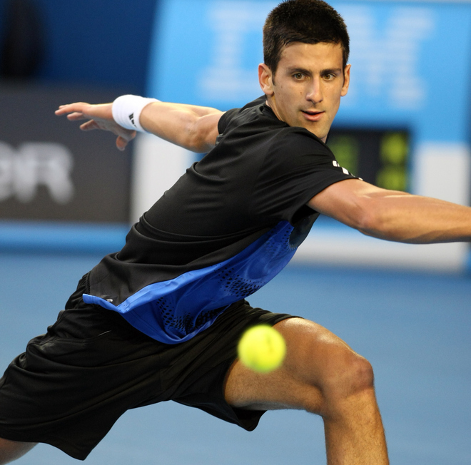 Serbian tennis player Novak Djokovic watches the ball as he plays a stroke during his mens singles final against French opponent Jo-Wilfried Tsonga at the Australian Open tennis tournament in Melbourne, 27 January 2008.  The match is tied at one set all as play continues.   AFP PHOTO/Torsten BLACKWOOD (Photo credit should read TORSTEN BLACKWOOD/AFP/Getty Images)