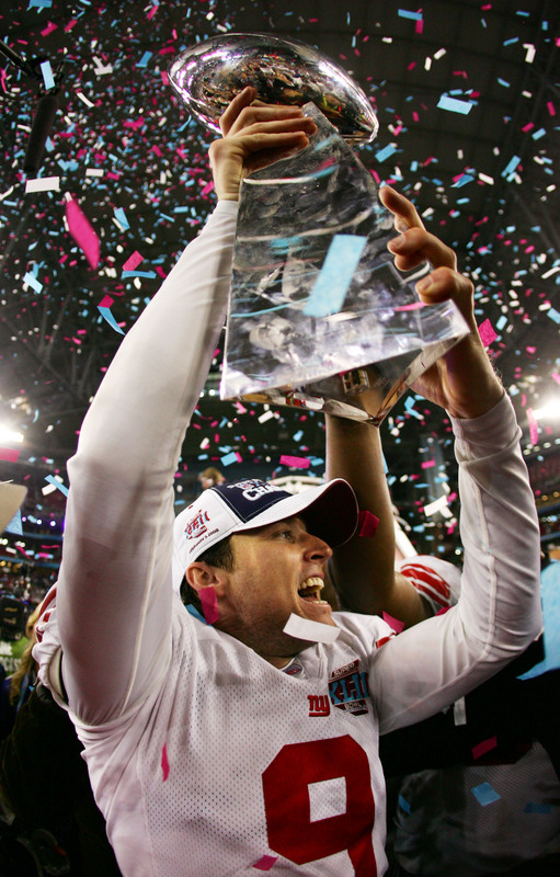 GLENDALE, AZ - FEBRUARY 03: Kicker Lawrence Tynes #9 of the New York Giants holds the Vince Lombardi Trophy after defeating the New England Patriots 17 0 14 after Super Bowl XLII on February 3, 2008 at the University of Phoenix Stadium in Glendale, Arizona. (Photo by Harry How/Getty Images)