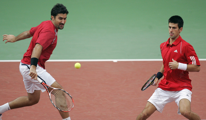Serbian Novak Djokovic (R) and Nenad Zimonjic return a servise to Russian Mikhail Youzhny and Dmitry Tursunov during their Davis Cup World Group clash in Moscow on February 9, 2008. Serbia's star player Novak Djokovic the latest Australia Open winner got back after missing the opening day's action suffering from flu-like symptoms.   AFP PHOTO/ ALEXANDER NEMENOV (Photo credit should read ALEXANDER NEMENOV/AFP/Getty Images)