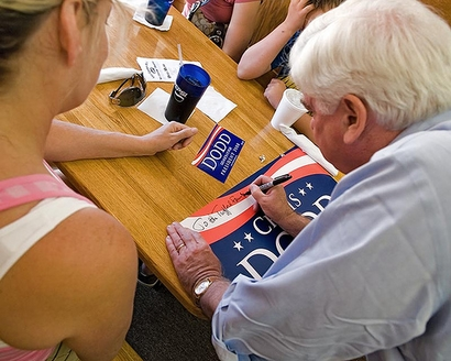 Senator Chris Dodd, Democratic Presidential hopeful, signs a ...